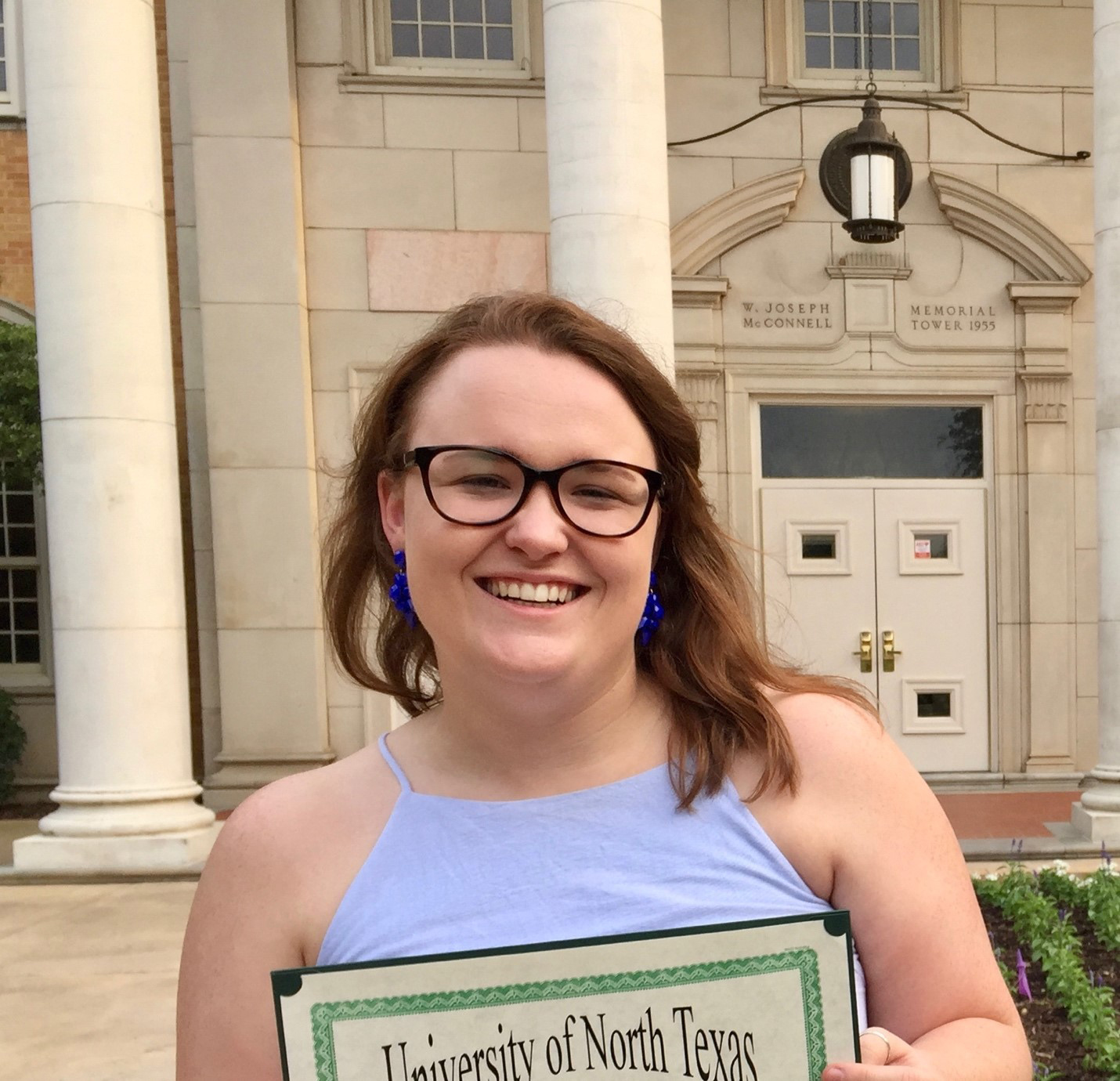 Hannah Horick in front of Hurley Administration Building
