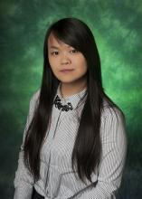 Photo of Caroline Leung on green background