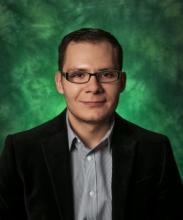 Photo of Cesar Baltazar on green background