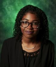 Photo of Fre'Dasia Daniels with a green background