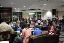 Students in lounge watching 2016 presidential debate on tv