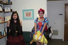 Girls posing in Halloween costumes