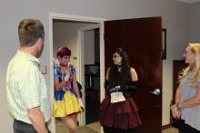 Russ and Rachel talking to trick-or-treaters