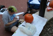Student looking for pumpkin carving designs