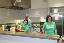 Students and staff members making pancakes