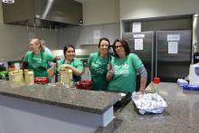 Honors College staff members making pancakes