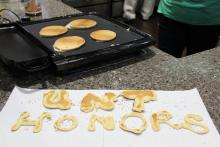 """Pancakes shaped like the words """"UNT Honors"""""""