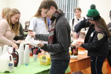 Students putting toppings on their pancakes
