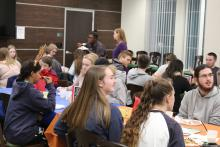 Students waiting to eat pancakes