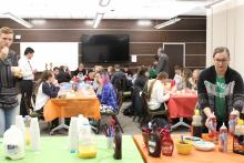 Students eating pancakes and drinking orange juice