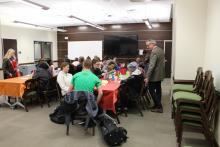 Dr. Major talking to students who are eating pancakes