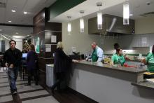 View of the kitchen that staff members are making pancakes in