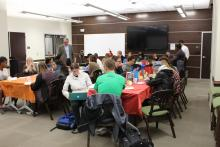 Students sitting at tables and eating pancakes