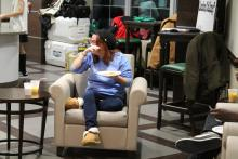 Student sitting in chair while eating pancakes