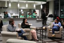 Students in lounge area eating pancakes
