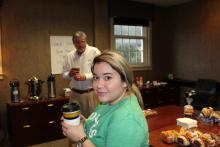 A student and Dr. Duban holding coffee cups