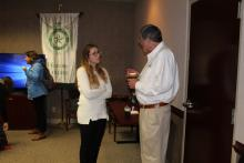 Dr. Duban talking to a staff member