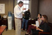 Dr. Duban talking to students