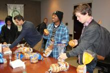 Several students getting bagels