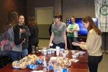 Students discussing the bagels