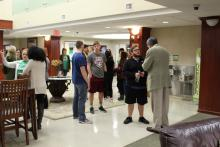 Dr. Duban greeting students in the Honors Hall lounge