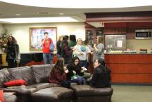Students sitting on a couch in the Honors Hall lounge
