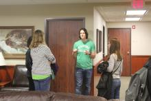 Students having a conversation in front of a door in Honors Hall