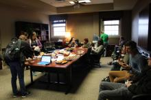 A room full of students eating bagels