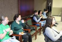 Several students sitting around the meeting room