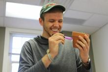 Bryan holding a marker to a pot