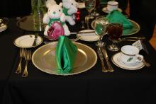 A place setting on a black table cloth