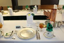 A place setting on a white table cloth