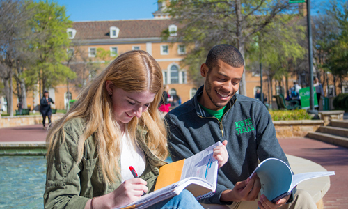 A photo of two students studying