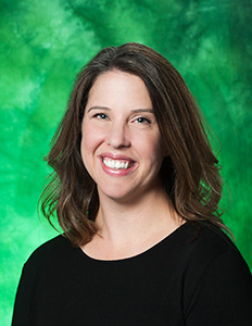 Photo of Dr. Bethany Blackstone with a green backdrop