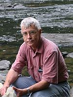 Photo of Dr. James Kennedy in front of a stream