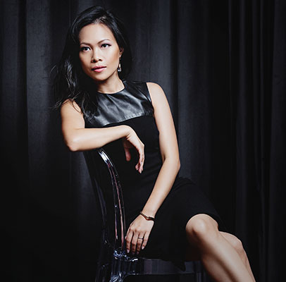 Photo of Khanh Nguyen with a black backdrop