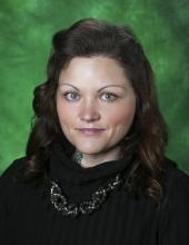 Photo of Jessica Luther Rummel with a green background