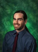 Photo of Logan Karwoski with a green background